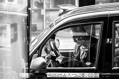 Taxi! (Blasius Kawalkowski) Tags: street photography black white bw faces decisive moment portrait scene strassenfotografie city snap unposed candid bnw taxi newspaper london car cab wait crossword pause