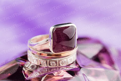 Gold ring with purple gemstone (Aleksa Torri) Tags: jewelry white background stone gold agat gemstone gem beauty closeup fashion expensive precious gift luxury golden vinous garnet violet purple accessory amethyst beautiful bijouterie design elegance engagement female jewel macro object shape silver treasure wedding style feminine valentine shaped stilllife fine romantic romance boudoir glamour woman square ring tribal modern