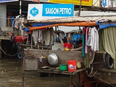 Child's play (program monkey) Tags: vietnam mekong river delta cargo boat ben tre tra vinh hanging laundry child kid play plastic bottle
