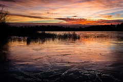 Frozen lake [explored] (daniel_munch) Tags: adventure blue clouds cold colors day environment forest frozen grass ice lake landscape nature outside red sky sunset travel tree water winter wow