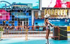 Poor lonesome naked cowboy (Phg Voyager) Tags: newyork city usa urban cowboy nakedcowboy sony a750 color outdoor street phgvoyager funny buildings singing guitar empty cityscape photography timessquare square a700 nyc summer vacation