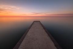 morning glow (Marc McDermott) Tags: long exposure sunrise morning summer calm serene tranquil beautiful warm water sky pier horizon clouds neutral density 10stop bw toronto ontario canada beach beaches