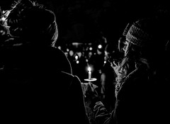 Candle and Cookie (Cheryl Atkins) Tags: girls cookie candle noflash nightphotography fujix 35mm monochrome blackandwhite