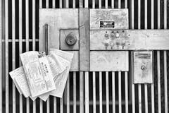 Frequent Fliers (CarbonNYC [in SF!]) Tags: door bw metal gate lock doorbell doorbells fliers
