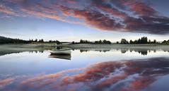 Idyllic (Giovanni Giannandrea) Tags: sunset reflections landscape scotland redsky fishingboats picturesque idyllic trossachs redclouds lochrusky