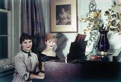 My aunt from Los Angeles (left) and my mom at the piano at a friend's apartment in Manhattan.  It just doesn't get much more 1950s looking than this. The hair, the clothes, the lipstick.  March 1953. New York. (wavz13) Tags: family 1950s oldfashion kodachrome oldphotographs oldphotos oldnewyork oldfamilyphotos oldslides vintagephotos vintageclothes oldphotography vintageclothing vintagephotographs 1950sfashion oldclothes oldpaintings vintagefashion familyphotography vintagepaintings vintagephotography vintagenewyork vintagefamilyphotos 1950sclothing oldclothing 1950sphotos oldmanhattan 1950skodachrome oldkodachromes 1950sphotography vintagemanhattan oldpianos vintagekodachrome 1950sclothes vintagepianos 1950sphotographs oldkodachrome vintagefamilyphotography 1950slife oldfamilyphotography