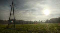 A III (Erich Hochstöger) Tags: sunset sky sun backlight clouds landscape lumix austria österreich sonnenuntergang meadow wiese himmel wolken panasonic landschaft sonne niederösterreich hdr gegenlicht electricitypylons strommast loweraustria fz150