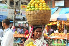 Basket-on-head vendor (bluelotus92) Tags: people india streets fruits basket market vendor oranges karnataka mysore scowling fruitvendor mysuru orangebasket devarajursmarket devarajaursmarket