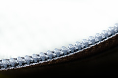 Holding back the light (pedanticsemantic) Tags: ykk inarow teeth white black macromondays macro zipper