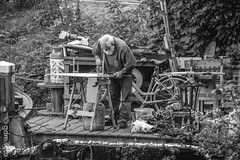 working old man (gerard de mooij) Tags: zwolle holland netherlands old man grey beard working hard boat city stad nederland bw