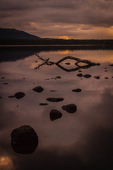 Sunset on the Lake (steelegbr) Tags: cairngorms highlands scotland uk autumn branch clouds country countryside evening fall forest lake loch nationalpark orange outdoors rocks rural seasons sky sunset trees twigs