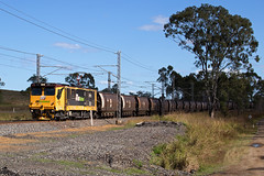 Past the trees (PJ Reading) Tags: aurizon qr qrnational queensland rail railway train cargo goods freight locomotive qld australia transport transportation electric electricity coal mineral bulk export gladstone blackwater rockhampton northcoast central ncl 3800