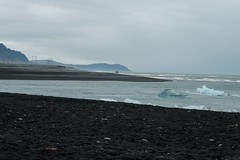 Jokullsarln, icebergs flowing by (Eleonora Sacco | Pain de Route) Tags: sea mist mountains cold men ice standing island 50mm iceland nikon cloudy south icebergs d90