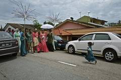 Ricoh GR street - little girl runs to receive a Malay wedding couple (mohamedyamin_masop) Tags: street wedding people ceremony culture malaysia gr tradition ricoh malay