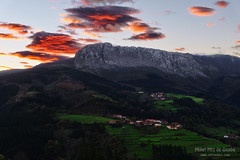 Itxina mountain with Zaloa and Urigoiti villages at sunrise (Mimadeo) Tags: red mountain mountains clouds rural sunrise countryside spain village peak bizkaia euskalherria euskadi orozco vizcaya basquecountry paisvasco massif gorbea zaloa itxina orozko urigoiti