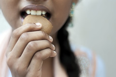 A Bite... (Yesmk Photography) Tags: girl closeup mouth hand eating teeth biscuit muthukumar yesmkphotography