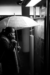 Bellevue.. (Cem Bayir) Tags: street leica winter blackandwhite bw monochrome night umbrella 50mm noiretblanc f14 rainy zrich fullframe summilux asph tramstation 5014 zh leicam asperical leicalove leicam240