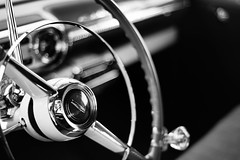 A Little Something on the Side (belleshaw) Tags: blackandwhite route66reunion carshow classiccar chrome steeringwheel emblem interior metal detail bokeh chevy bowtie reflections benchseat