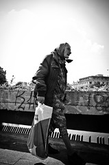 Poor Peasant in the Capital City (stimpsonjake) Tags: nikoncoolpixa 185mm streetphotography bucharest romania city candid blackandwhite bw monochrome oldwoman peasant poor