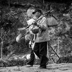 Hard workers happiness (Go-tea ) Tags: canon eos 100d street urban city china chinese asia asian poeple qingdao huangdao outside outdoor bw bnw black white blackwhite blackandwhithe old man people woman workers mountain duty helmet smile portrait wrinkless tools bag coat cold cap shovels carried waliking back home happy happiness hard life together team group bags bottles plastic collection