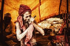 Sadhu! (Raghu Madanagopal) Tags: kumbhamela kumbhmela india indianimages sadhu nagasadhu natgeo nationalgeographic nashik smoking cannabis canon50mm people photojournalism portraits peopleofindia photojournalist raghumadanagopal raghu raghuphotography cwc