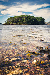 Lost (modesrodriguez) Tags: scotland highlands sea water trees island sky transparent polarizer