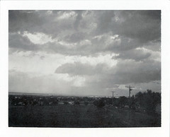 Tucumcari, NM (moominsean) Tags: polaroid 190 instant type667 expired092004 newmexico tucumcari sunset clouds monsoon summer dusk
