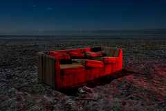 netflix and chill. bombay beach, ca. 2016. (eyetwist) Tags: eyetwistkevinballuff eyetwist abandoned couch netflixandchill bombaybeach saltonsea night desert dark nikon nikond7000 d7000 nikkor capturenx2 1024mmf3545g 1024mm fullmoon photography gel tripod npy nocturne longexposure derelict lightpainting ruin california imperial sonorandesert sonoran salton sea shoreline startrails american west bombay beach light ca111 trailerpark plaid cushions shoes garbage wasted netflix red water vintage old landscape seascape