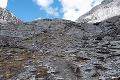 Descent (Vinchel) Tags: china sichuan siguniang trek outdoor mountain hiking fuji xt2 1655mm f28 landscape mountainside rock hill travel