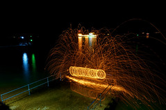 Steel Wool Spinning 2 (Lgh95) Tags: old portsmouth hampshire england united kingdom uk steel wool spinning fire flames spark sparks hot temperature beach sea water looking down rails stone pier jetty long exposure shutter speed