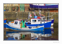 Sir Tristram (Seven_Wishes) Tags: newcastleupontynenortheast kc photoborder outdoor canoneos1dmarkiv canonef24105mmf4lis ouseburn rivertyne boats people reflections water moored flags ladder wall quayside sunny oil oilslick