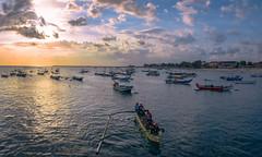 Fishermen Home From Sea (ben_leash) Tags: boat fishing fisherman fishermen bali sony a77 indonesia southeastasia sunset pier marine boats clouds cloud