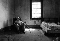 Ted Stein, 90 years old, revisits his old childhood home. (L. Paul) Tags: old blackandwhite bw abandoned window monochrome childhood sadness chair sad decay oldman indoor dirty oldhouse dirt elderly age abandonedhouse ia lonely grime mattress emptiness windowlight lonesome oldhome dirtywalls wever oldbed sadman sittinginchair elderlyportrait