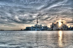 Toronto Skyline (blink to click) Tags: sunset sky toronto ontario canada water skyline architecture clouds buildings cityscape cntower skyscrapers click rays thedocks blink hdr downtowntoronto torontoskyline polsonpier nikond80 blinktoclick