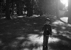 Forrest (Bairon Rivera) Tags: light bw white black fall hat dark kid sticks woods alone sweet outdoor dramatic playfull concept