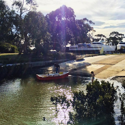 265/365 • first paddle of the season... #M is getting out #Oomoo for our lovely friends to cruise around the creek - they hope to land a 🐟 • #265_2015 #5yo #Spring2015 #inlet #mysmallboat #sunshine #boatyard #Westernport