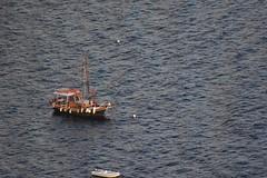 Boat (Nagarjun) Tags: blue sunset sun white church island volcano evening europe glow santorini caldera oia cyclades mediterranian firostefani aegeansea