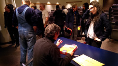 PRC Lecture: Mike Mandel signing Sarah Pollman's boxed set (PRCBoston) Tags: boston prc bostonuniversity smfa mikemandel photographicresourcecenter schoolofthemuseumoffineartsboston prclectures baseballphotographertradingcards