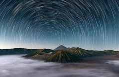 Sleeping Giants || Mt Bromo Indonesia () Tags: wallpapers 0landscapesandatmosphere 0portfolio 0portfolioexpanded d800 penanjakan semeru tenggermassif asia bluehour bromo caldera clouds fog indonesia landscape longexposure mountains night portfolio portfolio2 startrails stars travel wideangle