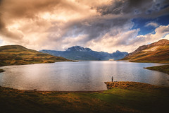 The Catch (Chrisnaton) Tags: tannensee fisherman alplake fishing switzerland clouds mountains hills autumn thecatch