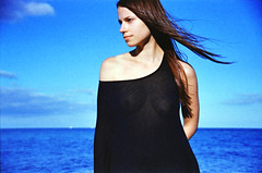 (Juliet Alpha November) Tags: solaris ferrania 200 expired film 35mm analogue analog bokeh outdoor portrait portrt hair haar wind windy windig ocean meer sky himmel clouds wolken black dress model salvaje jan meifert