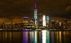 """Reflections of Manhattan"" New York City, NY (Cathy Lorraine) Tags: reflections manhattan newyorkcity newyork stormclouds lights cityscape nightscape hudsonriver jerseycity colors sky river"