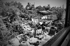 Child of Yangons countryside (jon_med) Tags: myanmar yangon slum poor sad countryside trash train asia rangun burma boy child environment responsibility