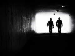 synchronized (Sandy...J) Tags: olympus monochrom fotografie mono noir sonnenlicht blackwhite bw darkness dunkelheit durchgang people gegenlicht backlight streetphotography sw schwarzweis silhouette urban underpass light walk walking