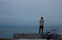 (Georgina ) Tags: outdoor sea mountains athens greece bicycle graffitti stonewall music headphones listening reflecting thinking view sweater man