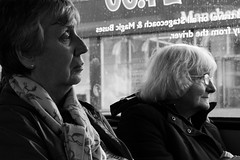 Riding Tired (mijkat) Tags: street uk ladies england people blackandwhite bw bus monochrome lines scarf canon manchester 50mm glasses coach candid pegasus earring ii tired older traveling coats f18 contemplative wrinkles ef stagecoach dirtywindow whitehair waterspots 550d