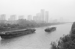 "Grand Canal, Wuxi (Xsbmrnr (Please read profile before ""following"") Tags: china blackandwhite film water canal noir wuxi noiretblanc olympus bandw schwartz f8 blanc zuiko barge om1 olympusom1 barges chinaimages xsbmrnrphotographycom"