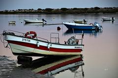 Reflexos ao pr do sol! (puri_) Tags: algarve reflexos ria gua barcos sunset praia areia picmonkey