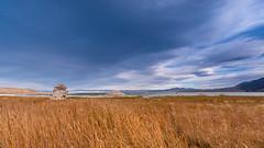 Mono Lake (Jaideep Mann) Tags: mono lake county tufa towers eastern sierra lee vining highway 395 tioga pass clouds sky rock formations grass sunset evening water