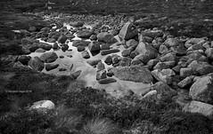 Rocks under water (III) [BW] (Modesto Vega) Tags: blackwhite cairngorms cairngormsnationalpark cloud coireanlochain d600 fullframe glacialcirque heather highland landscape monochrome mountain nikon nikond600 outdoor rock scotland sky stream unitedkingdom water